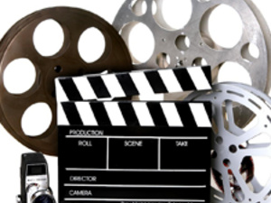 movie-making tools: cameras, film reels, and scene board