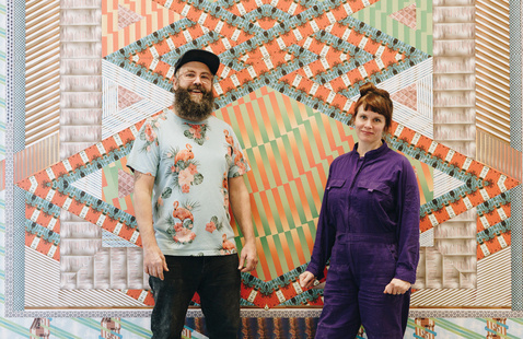 Adam Eckstrom and Lauren Was of Ghost of a Dream standing in front of a section of Yetserday is Here at the MassArt Art Museum. Photo: Daniel Berube.