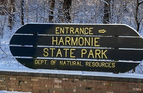 Snowy entrance sign at Harmonie State Park