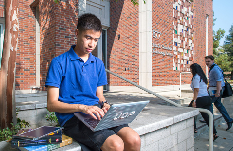 student using a laptop outside
