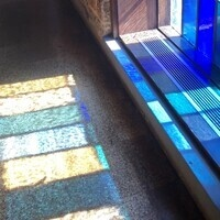 morning light through the blue stained glass windows in the Chapel