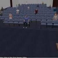 mock up of large lecture hall with few students in masked and socially distanced