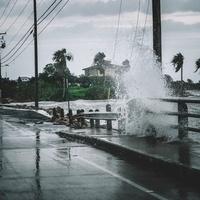 Wave crashing over roadway
