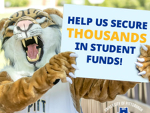 Bruiser the Bobcat holding sign: Help us secure thousands in student funds!