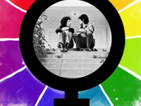 "Image of two women in a ""woman"" symbol surrounded by rainbows"