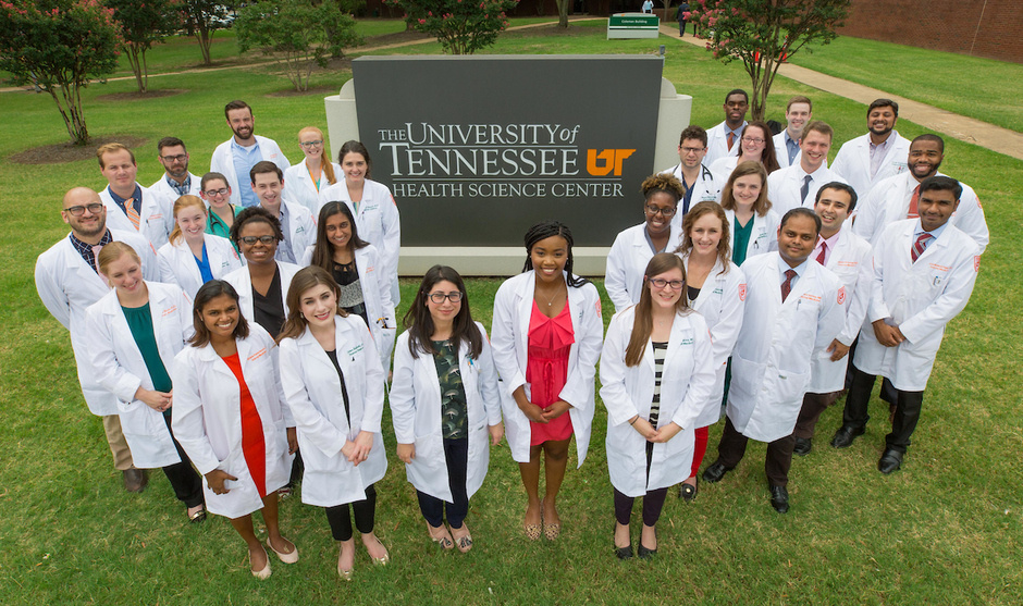 A group of Internal Medicine residents standing with a UTHSC sign.