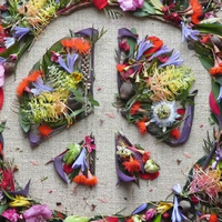 Peace sign made from flower petals