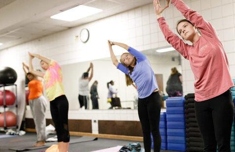Students doing yoga poses