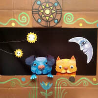 cat and dog puppets in puppet theater