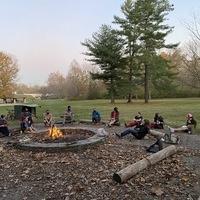 group around the campfire