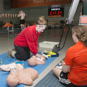 Students performing CPR on practice dummies