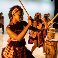 Women dancing with batons and drums