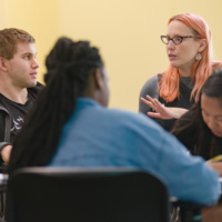 students having a discussion in a classroom