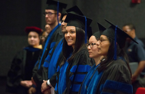 A photo of Graduate Health Sciences students in regalia at a commencement ceremony.