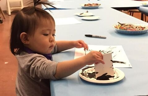 toddler with crafts