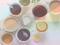 Cups of teas and coffees with creamer, mint, and lemon with a rainbow filter over the entire image.