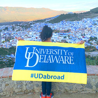 Student with #UDabroad flag
