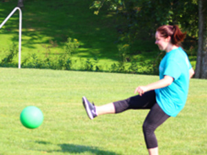 woman playing kickball