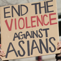 """handmade sign reading """"end the violence against asians"""""""