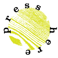 "text of ""press here"" in circular formation around a circular citron colored print of wood-grain, like a linocut print"