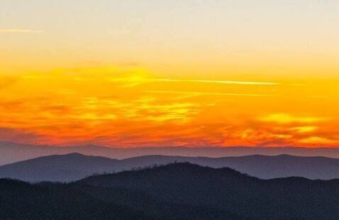 sunset above the mountains by Hitomi Silver