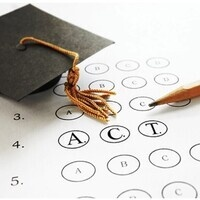 A black graduation cap sits atop a white sheet of paper. The paper contains black numbering 1 through 5 with lettered multiple choice bubbles after each number. The bubbles are labeled 'A' through 'D', except for the 4th row, whose bubbles are labeled 'A', 'C', and 'T', respectively.
