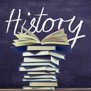 History written on a chalkboard above a stack of books
