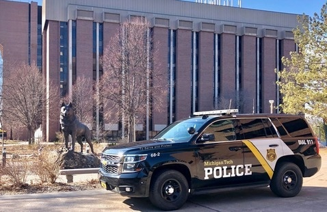 Michigan Tech Police Cruiser near the Husky Statue