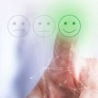 Picture of someone's finger choosing between 3 emoticons. One is frowning, one is straight faced, and one is smiling. The hand is choosing the smiling emoticon and it lights up green.