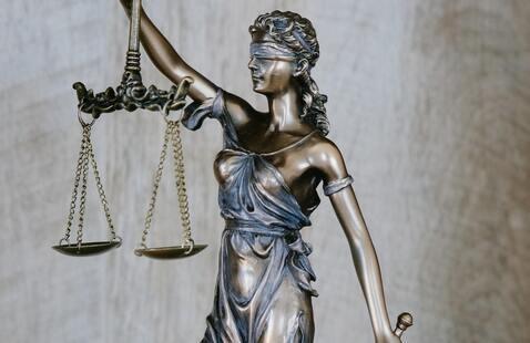 "Photo of ""Lady Justice"" by Tingey Injury Law Firm on Unsplash; Photo by <a href=""https://unsplash.com/@tingeyinjurylawfirm?utm_source=unsplash&utm_medium=referral&utm_content=creditCopyText"">Tingey Injury Law Firm</a> on <a href=""https://unsplash.com/?utm_source=unsplash&utm_medium=referral&utm_content=creditCopyText"">Unsplash</a>"