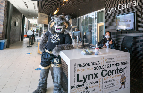 milo stands by the big white desk at LynxCentral