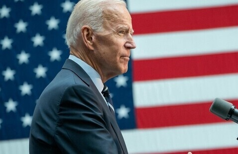 President Joe Biden in front of an American flag