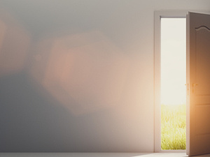 Door opens and reveals sunshine coming into a room
