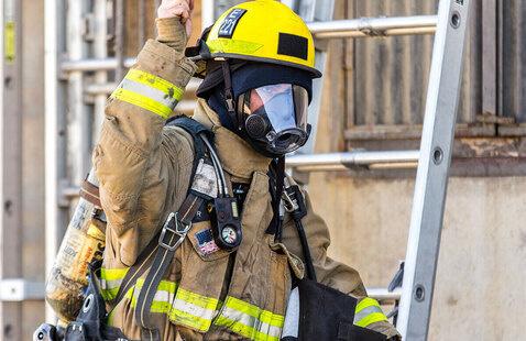 firefighter wearing safety gear