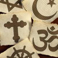 photograph of religious symbols printed on squares of parchment paper