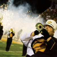 USM Pride of Mississippi Band Members Perform on the football field at a night game
