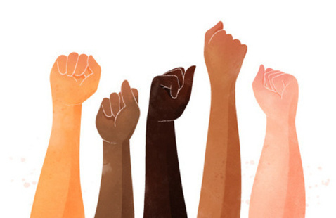 Diverse fists in the air