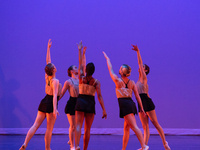 color photograph of five female dancers on stage