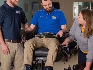 MRT students working with power wheelchairs