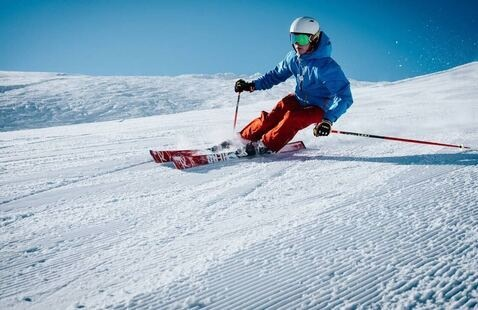 person skiing down slope