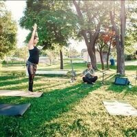 two people doing yoga on the grass