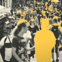 Crowded street scene with yellow cutout of a person