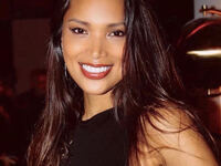 Headshot image of Geena Rocero.  She is wearing a black top and smiling.