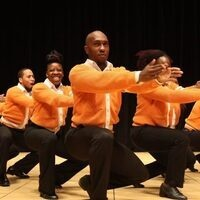 members of Step Afrika! participating in a stepping performance