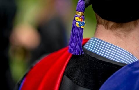 A close up image of a tam and tassel on a graduate.