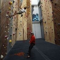 Two students at the climbing wall