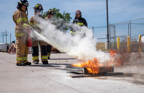 Aims student putting a fire out at the Xplore Academy summer camp