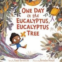 the cover of the book One Day in the Eucalyptus, Eucalyptus tree. It shows a young boy holding a pinwheel at the bottom of a eucalyptus tree. A snake is hidden among the leaves