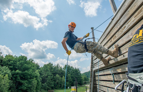 FLC participant on the rappel tower.