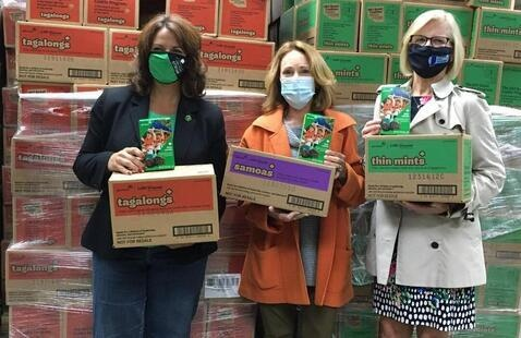 Girl Scouts of Central Indiana CEO Danielle Shockey, left, oversees the donation of Girl Scout cookies to support state COVID-19 vaccination efforts with Cathy Langham, president and CEO of Langham Logistics, and State Health Commissioner Kris Box, M.D., FACOG.